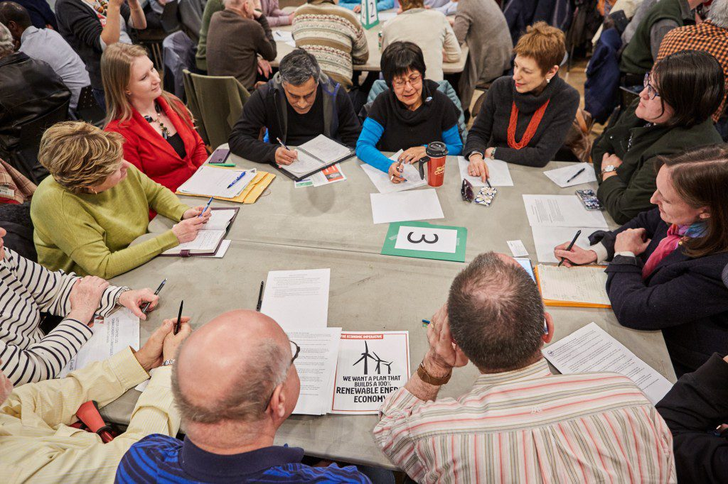 One of dozens of tables of people discussing climate action.
