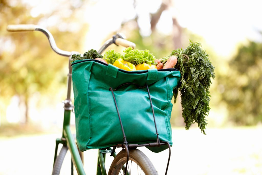 Cropped image of a bag of vegatables on a bike