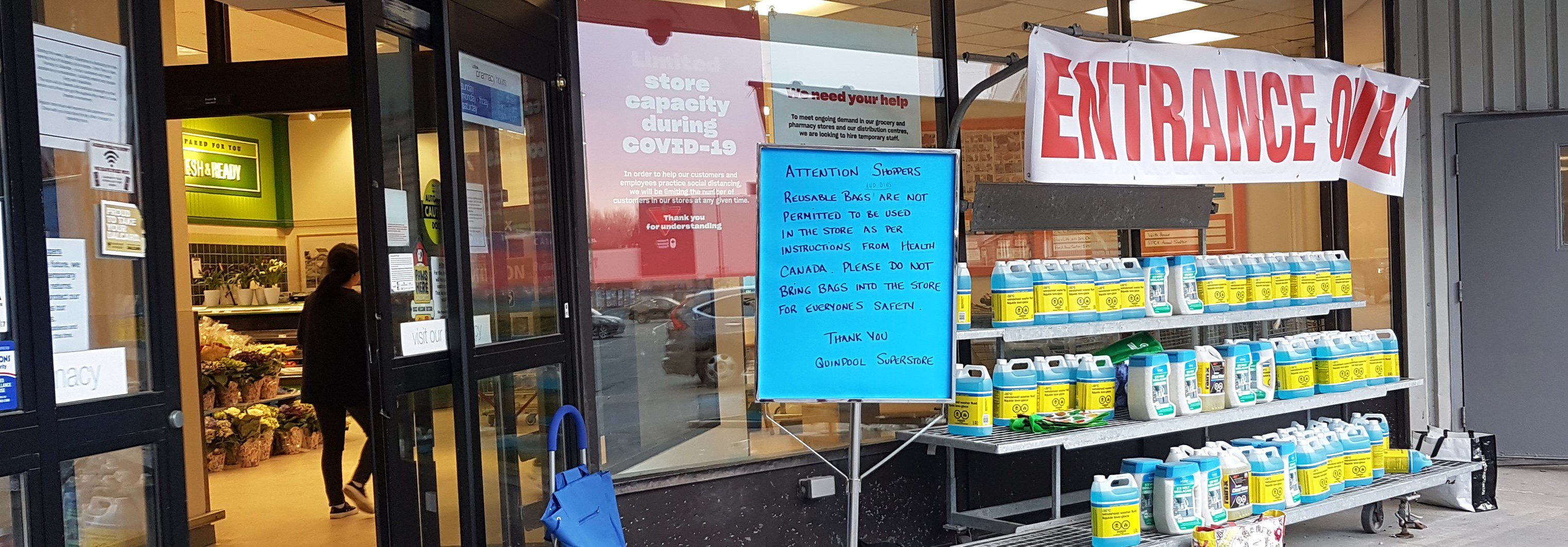 A sign in front of an Atlantic Superstore grocery store in Halifax, Nova Scotia, Canada, on April 8, 2020, is advising customers to leave reusable cotton bags outside of the store and not bring them inside for public health reasons during the coronavirus / covid-19 pandemic.